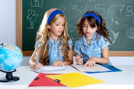 10215328-kids-students-in-classroom-helping-each-other-at-school-desk